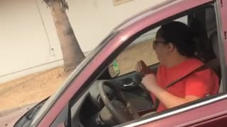 Woman hilariously caught dancing in her car