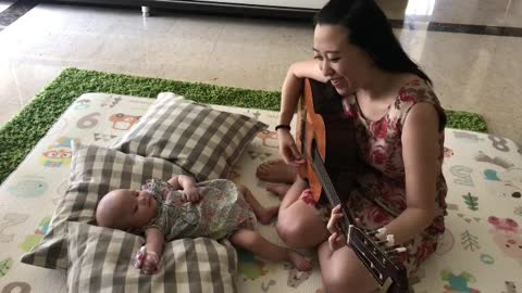 Mommy singing super sweet song for her baby