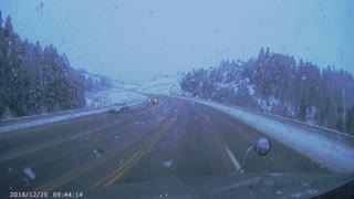 SUV on Snowy Highway Collides Head On with Semi - Video