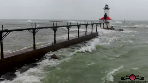 Insane monster waves crashing over lighthouse drone footage
