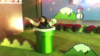 Music black hair woman dances on set of super mario brothers