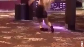 Drunk girl heels falls down on carpet and scorpions - Video