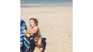 Collab copyright protection - baby falls on sand slow motion beer