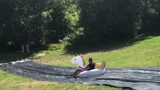Two people unicorn slip and slide fail