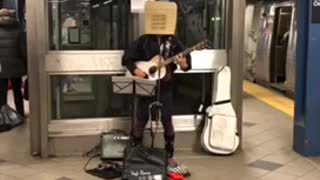 58 mezzanine street elevator guy basket head guitar subway