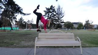 Flexible Girl Does Handstand on Bench