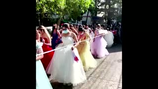 Women in ball gowns protest against Myanmar coup