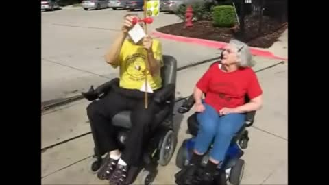 Two Seniors Drag Race In Electric Wheelchairs