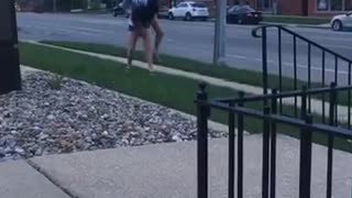 Two guys trying to do between the leg front flip fails face plant into grass - Video