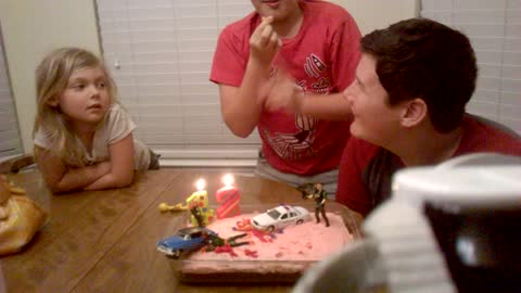 Boy Puts Out His Birthday Candles With His Fingers