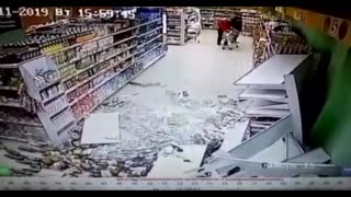 Supermarket Booze Aisle Shelves Collapse As Man Walks By