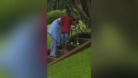 Boy Helps Elderly Woman In Beautiful Video
