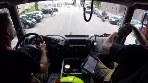 Footage from inside a firetruck rushing to a fire scene
