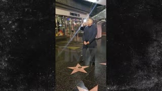 George Lopez pretends to urinate on Trump's Hollywood star. - Video