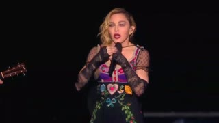 Madonna pays teary tribute to Paris victims at gig - Video
