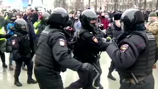 Moscow police grab Navalny supporters before rally