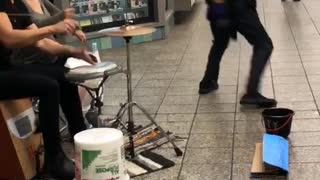 Subway drummers man white tank top wife beater dancing
