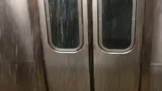 Flood waters fall in front of subway doors - Video