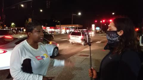 Brave Woman Wades Into The Middle Of Protesters To Tell Them To Stop What They're Doing