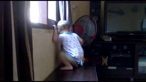 Baby dances out the window.