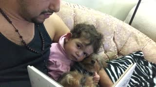 Baby and puppy fall asleep during bedtime story