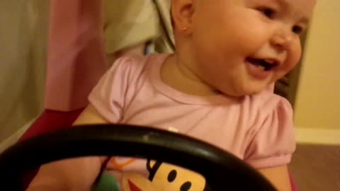 Baby takes toy car for a joy ride
