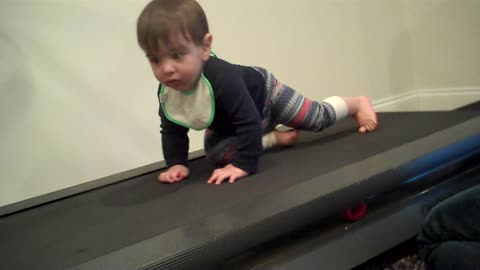 Determined baby hits the treadmill