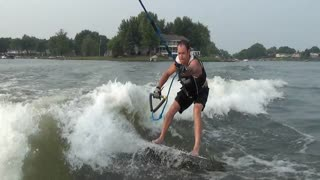 Guy completes his first wake surf 360 - Video