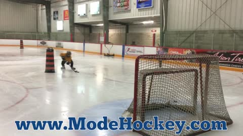 7-year-old shoots puck better than you!