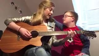 Girl Plays Original Song For Brother With Down Syndrome  - Video