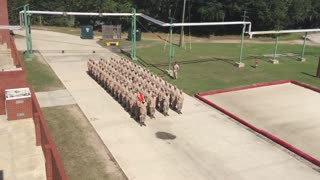 Platoon of Marines perform flawless trick drill - Video