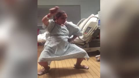 Expectant Mom Dances With Happiness At The Hospital