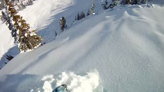 Daredevil Snowboarder Has Close Encounter With Mini Avalanche - Video
