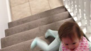 Baby slides down stairs on her stomach - Video