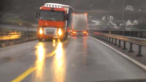 Driver's terrifying moment when oncoming truck almost tips over