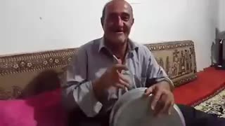 Man Sings and Plays Music with Pot - Video