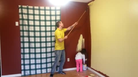 "Daddy & Daughter Team ""work it"" to painting"