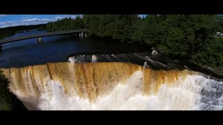 Breathtaking aerial flyover of a waterfall