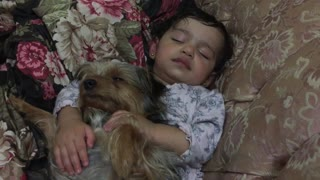 Dog preciously falls asleep with sleeping baby