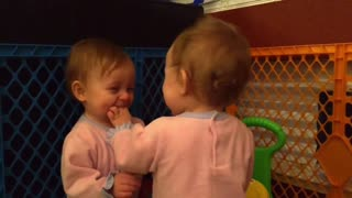 Twin babies share heart-warming moment