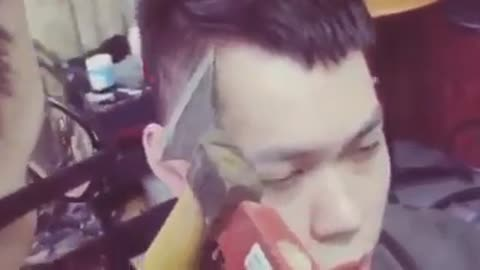 Man gets a hair cut with knife and hammer