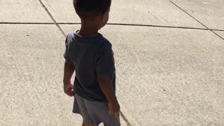 Toddler Spreads Love by Giving Water to Garbage Truck Driver