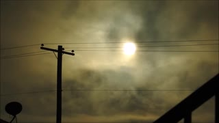 The Sun Through Power Lines and Clouds with a Nikon P900  - Video