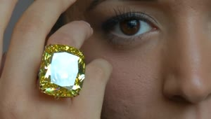 Rare yellow diamond fetches record breaking $16 million - Video