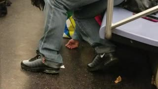 Grey pants woman passed out bent over seat subway