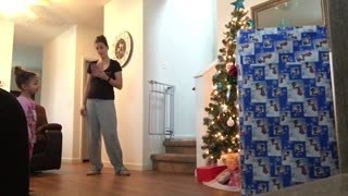 Little Girl Unwraps Military Dad - Video
