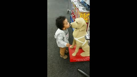 Toddler confuses dog statue for actual dog