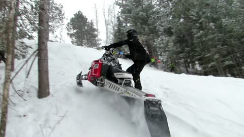 Into The Trees Dusting A Hill Jockey! | Just Snowmobiles