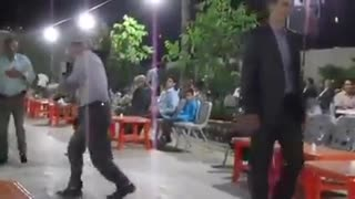 Old man dancing in a wedding party