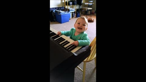 Baby extremely amused by piano playing